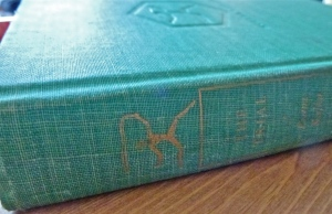 It's so old you can hardly see the title which is embossed in gold on the green fabric.